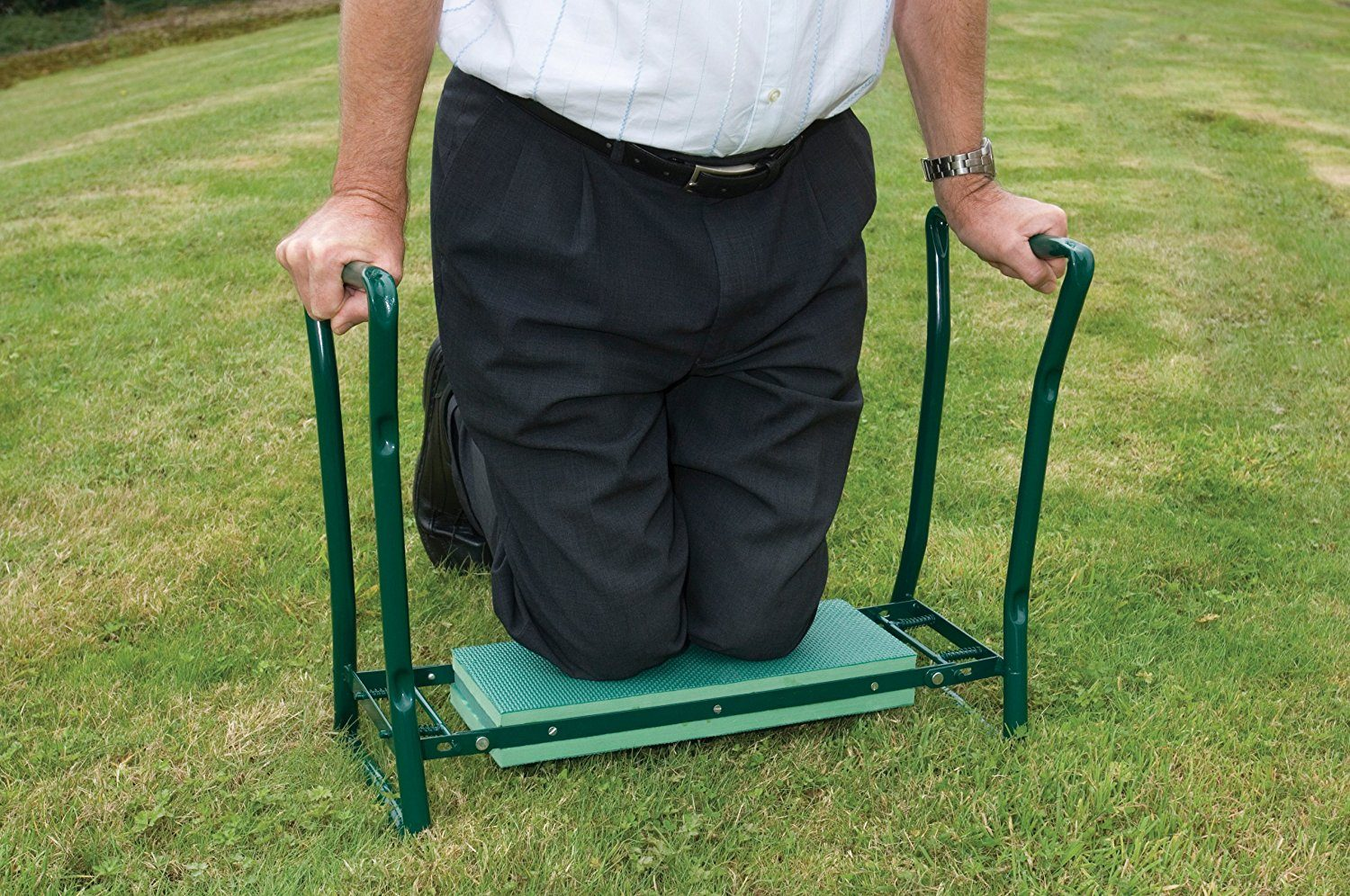 male gardener kneeling on a kneeler seat