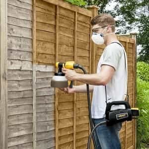 spraying a fence
